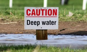 Caution Deep Water Sign for Flooding