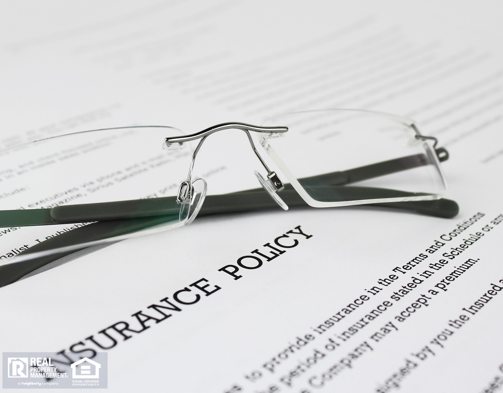 Merced Renter's Insurance Policy with Glasses Propped on Top