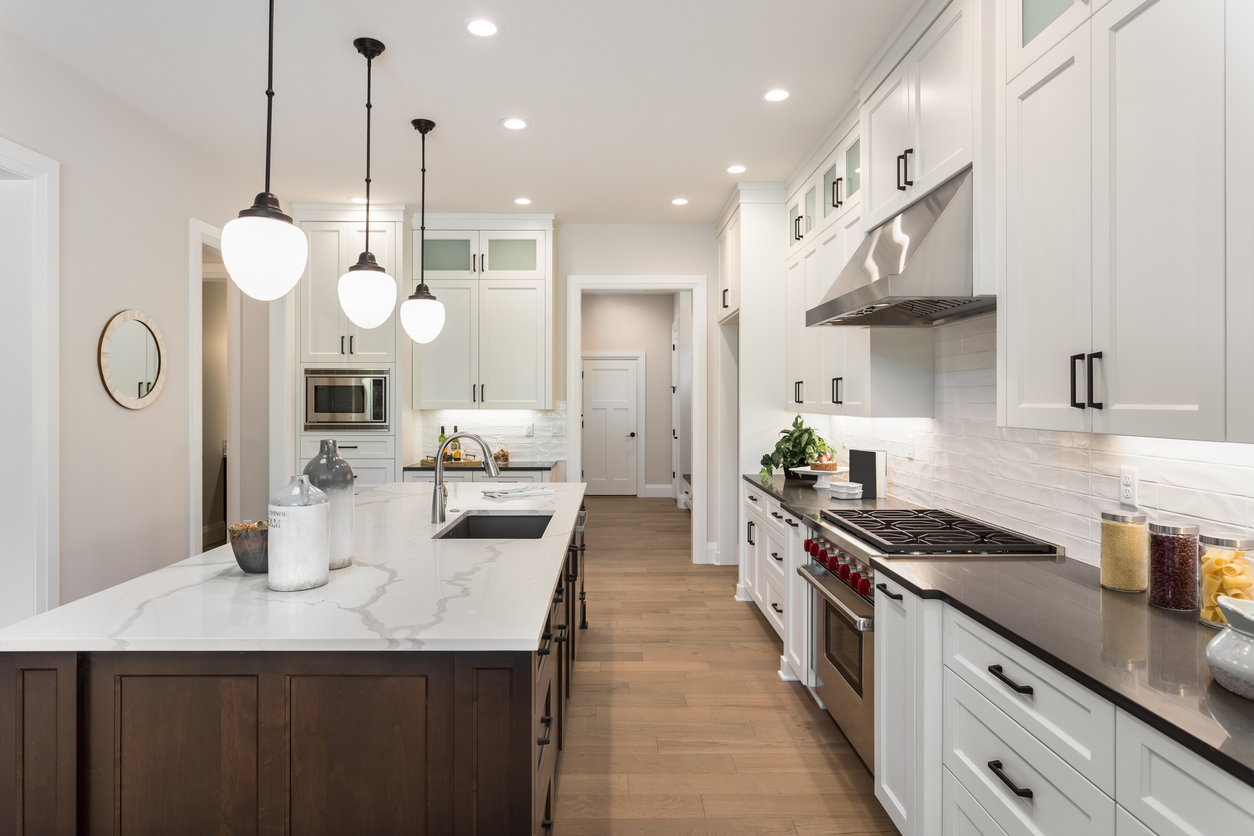 South Austin Rental Property with Hardwood Flooring and Granite Countertops in Their Upgraded Kitchen