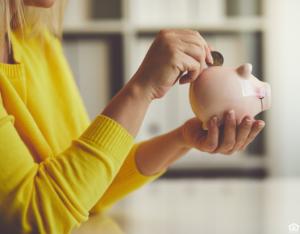 Buda Woman Saving Change in a Piggy Bank