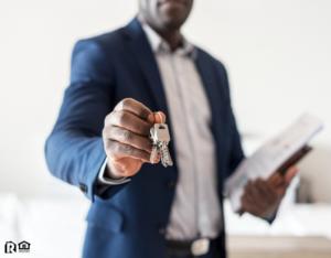Austin Real Estate Investor Holding Out a Set of Keys