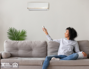 Woman controlling new air conditioning unit with remote