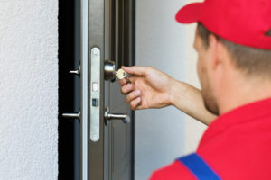 Locksmith Rekeying Front Door of Rental