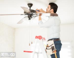 Handyman Installing a Schaumburg Fan in Delta