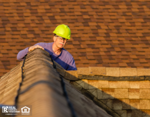 Home Inspector Looking at a Rolling Meadows Rental Property Roof