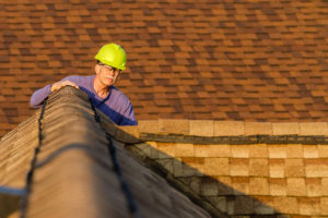 Home Inspector Looking at a Jenks Rental Property Roof