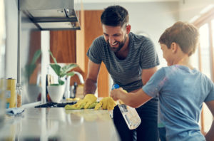 Father and Son Cleaning Kitchen Together