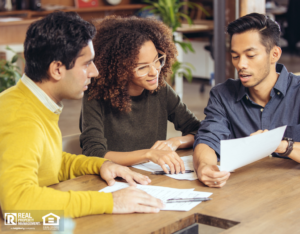 Property Owner and Tenants Discussing Terms During A Lease Signing