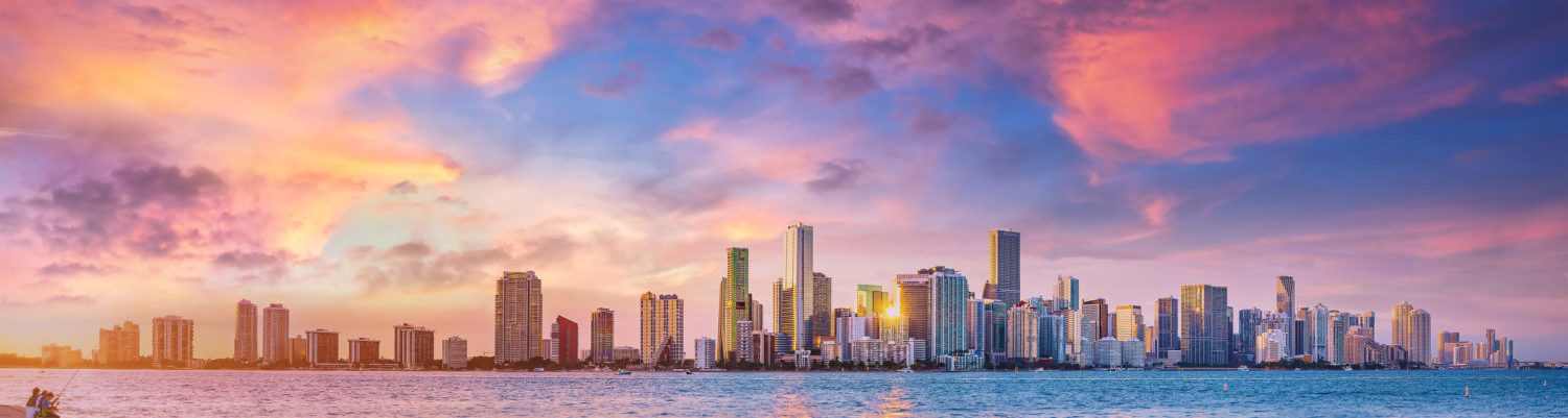 the skyline of miami during sunset