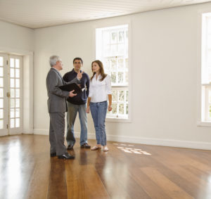 Realtor Showing a Vacant Property to a Couple in Sugar Hill