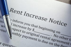 Ballpoint Pen On Top Of Rental Increase Notice