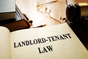Open Landlord-Tenant Lawbook on a Desk