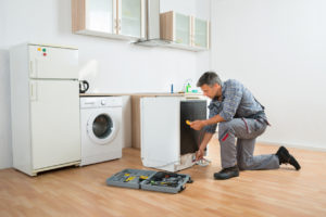 Greensboro Property Manager Doing Maintenance on Appliances