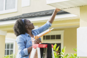 Woman Making Repairs to Her Rental Property in Williamsburg