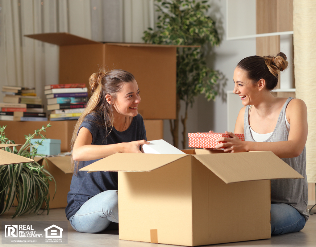 Roommates Unboxing Belongings in Toano Rental Home