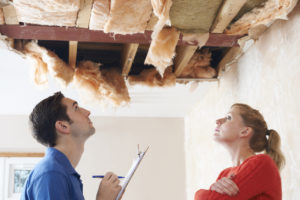 Contractor and Property Owner Inspecting Roof Damage