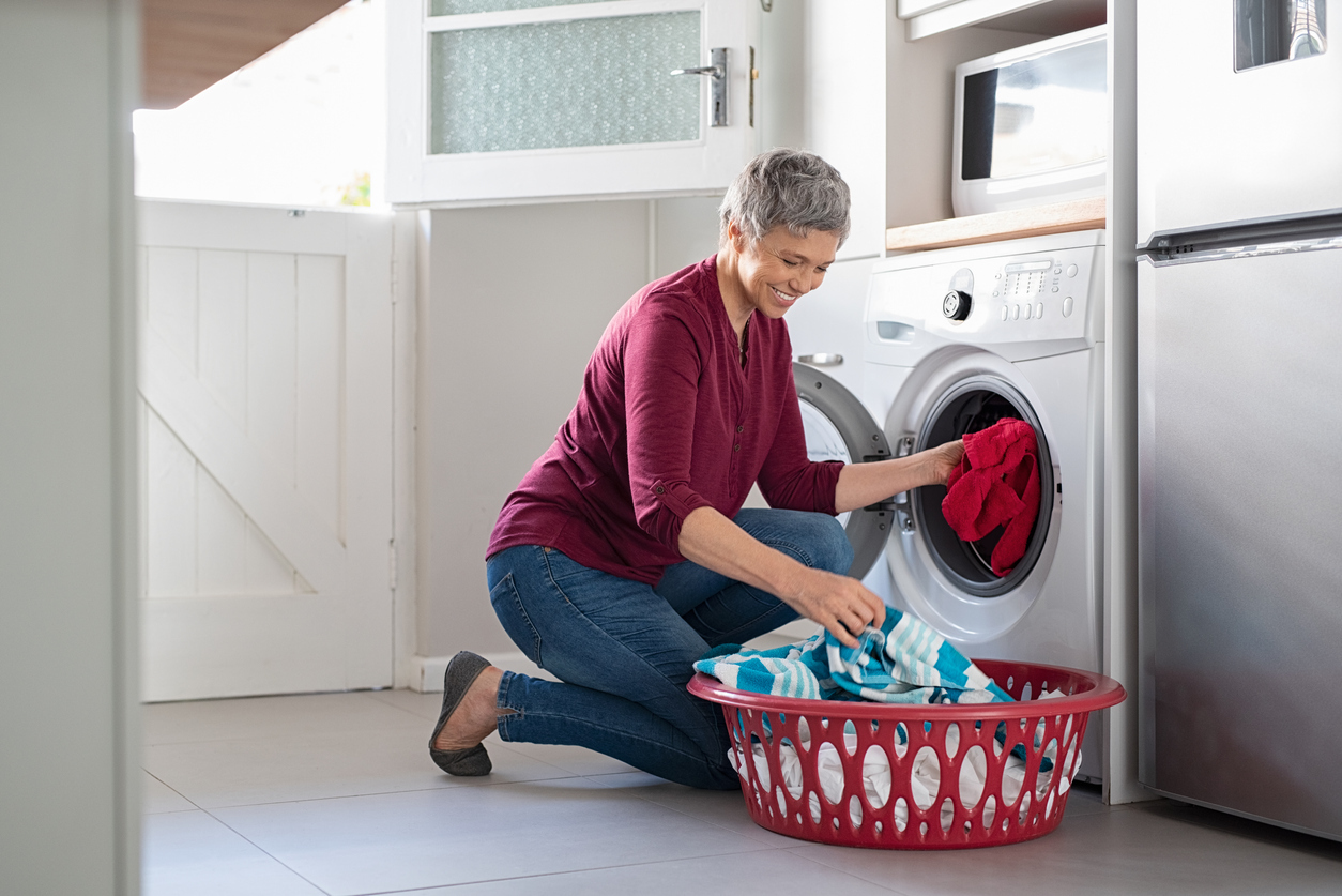 Older Woman Doing Laundry with a New Appliance