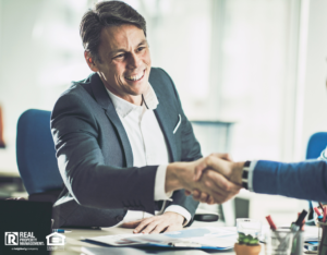 Richland Investor Shaking Hands with a Business Partner