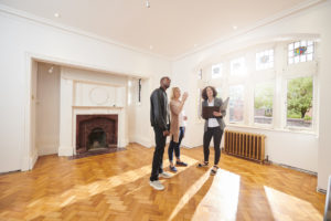 West Richland Real Estate Agent Showing Property Investors a Refurbished Home
