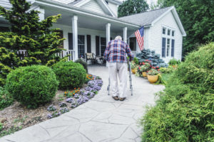 Elderly West Richland Man Walking Up the Path to the Front Door