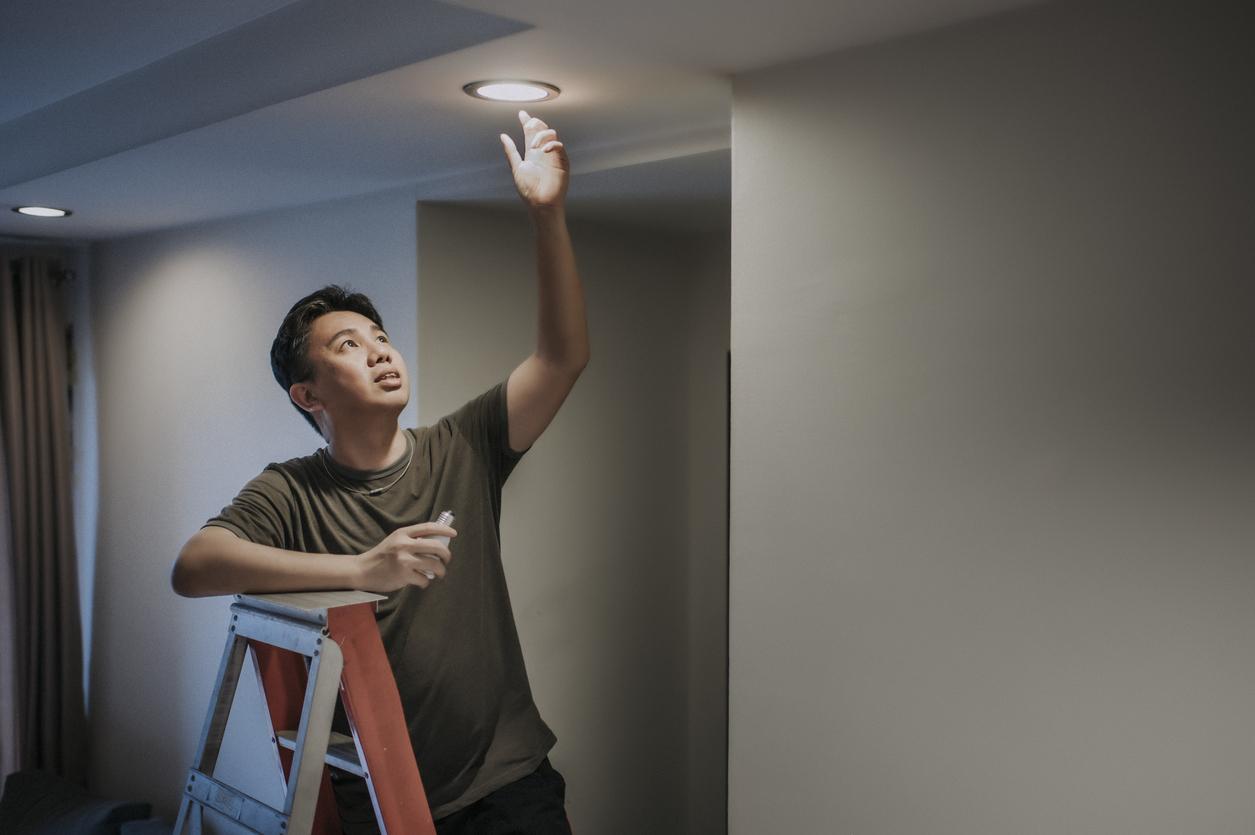 Benton City Tenant Changing a Lightbulb