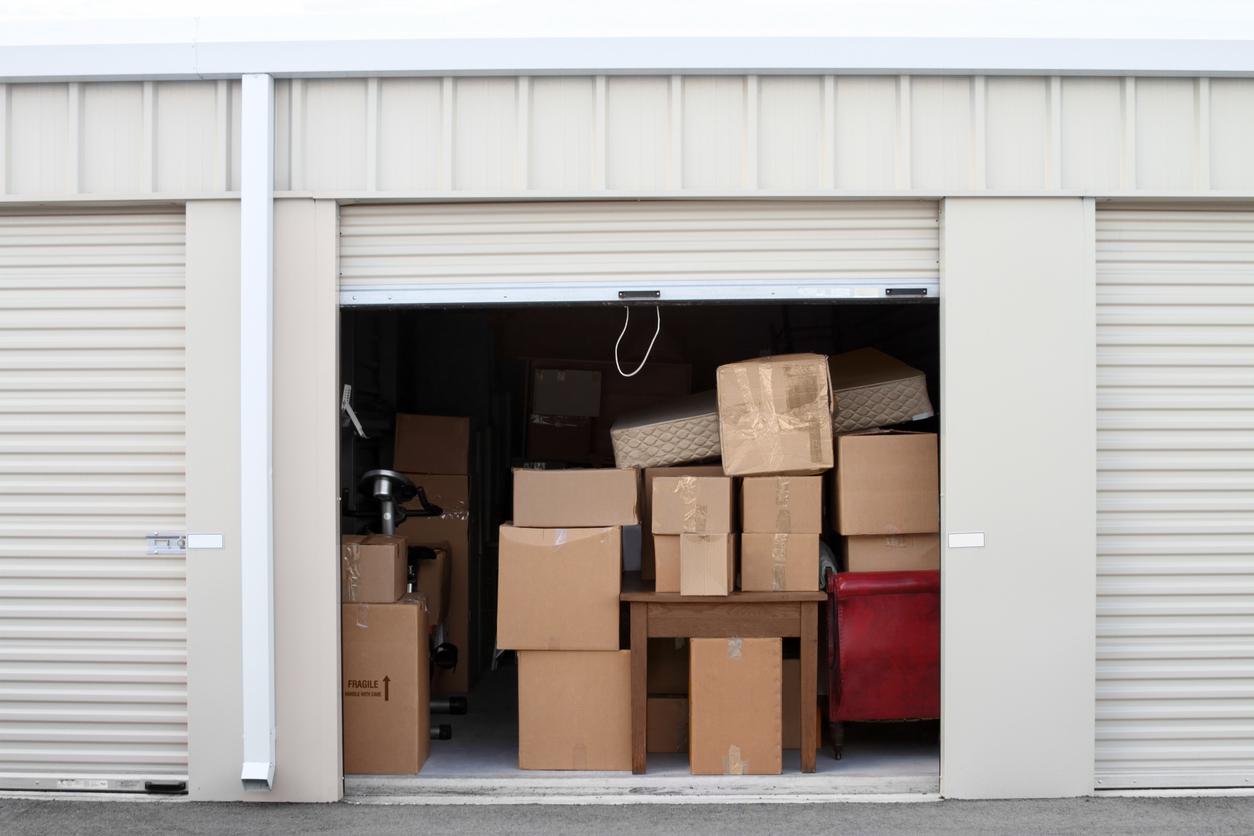 A Storage Unit Filled Completely with Boxes and Furniture