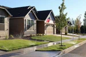 North Logan Rental Property Watering Their Lawn with Sprinkler System