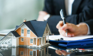 Signing Papers After the Purchase of an Investment Property in Wellsville