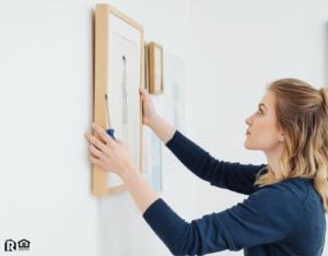 Spokane Tenant Hanging Artwork in Their New Home