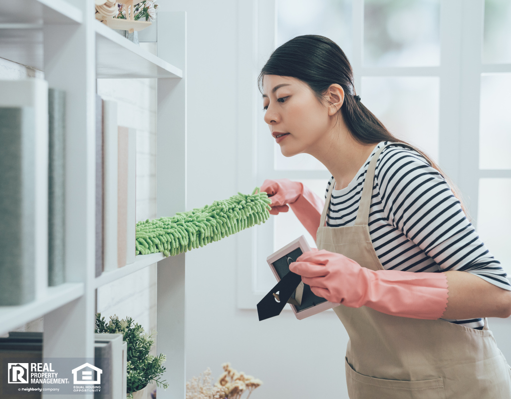 Airway Heights Woman Dusting a Shelf
