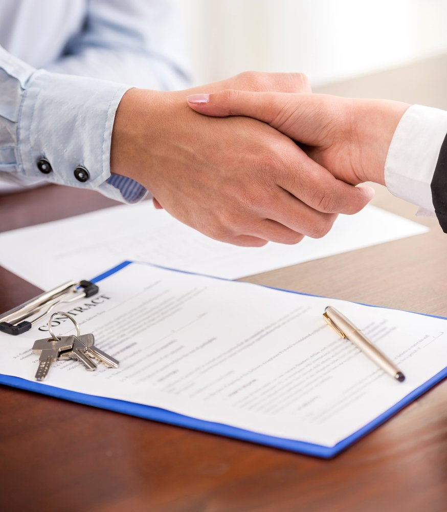 handshaking business deal property manager and client