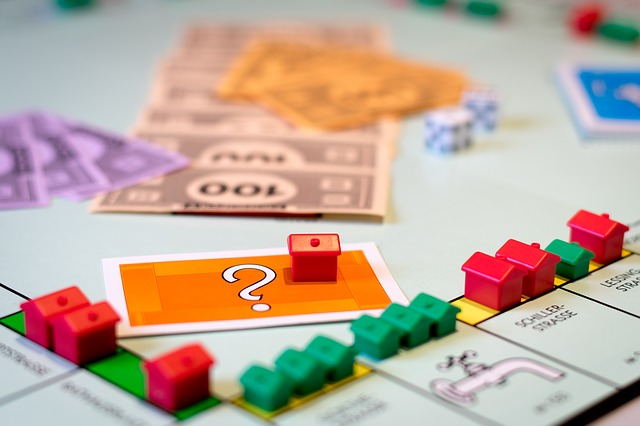 A Monopoly Board with Monopoly Money and Game Pieces