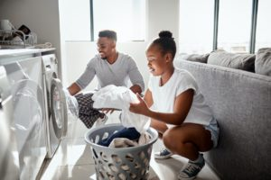 Converse Couple Doing Laundry