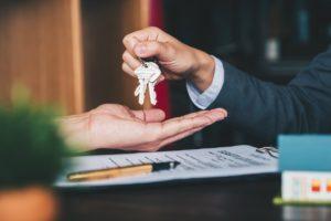 Norfolk Investor Being Handed a Set of Keys