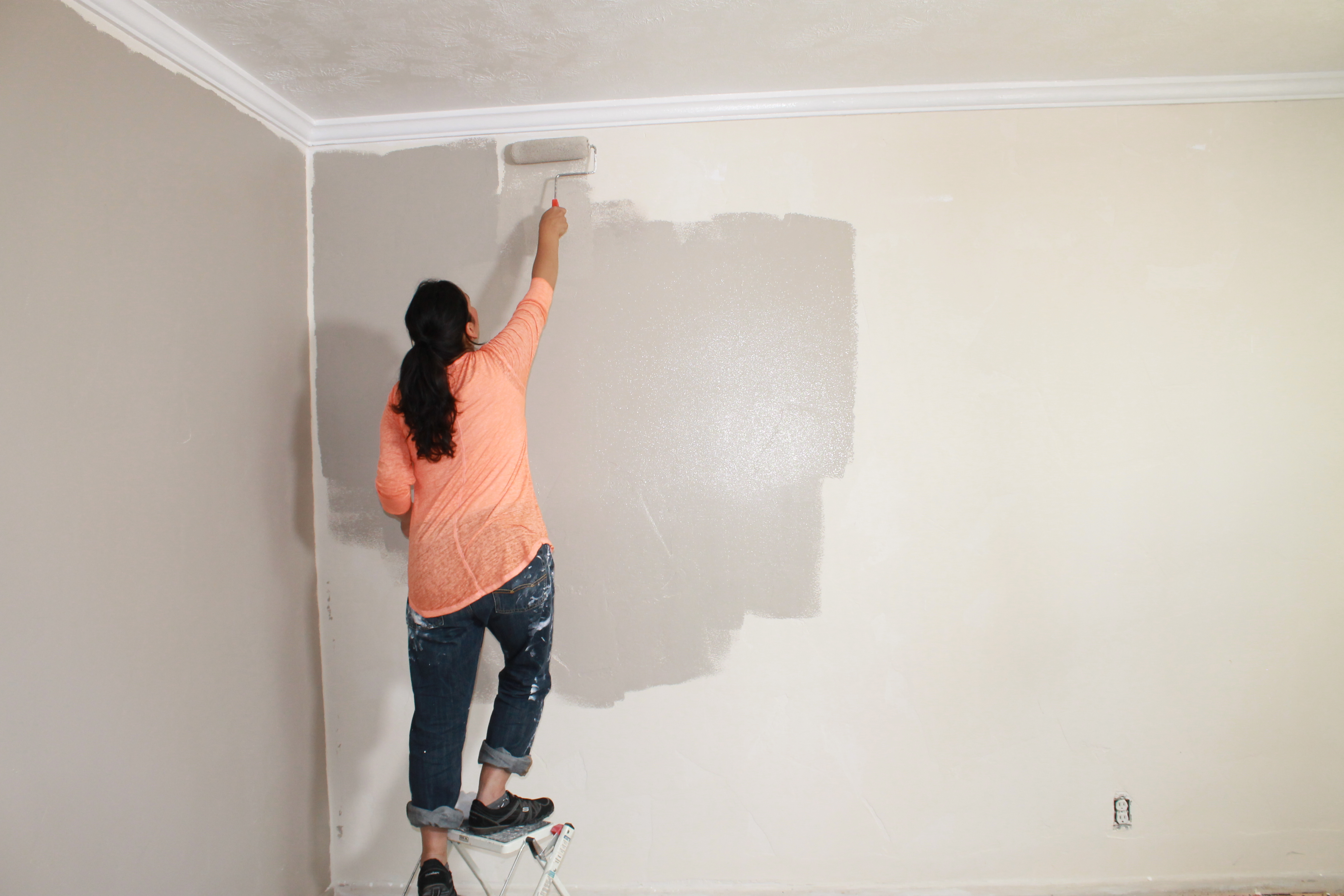 A Resident Painting the Wall