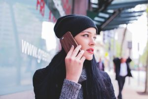 hipster woman on phone outside