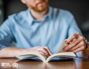 Millbury Real Estate Investor Reading an Informative Book
