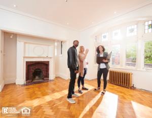 Hudson Real Estate Agent Showing Property Investors a Refurbished Home