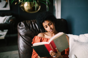 Woman Relaxing in Her Acton Reading Nook
