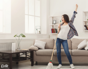 Mobile Woman Tidying the Living Room