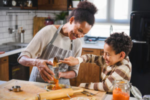 Mother and Son Taking Part in Fall Activities by Baking