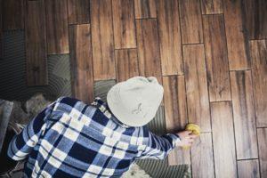 Man Installing Plantation Flooring