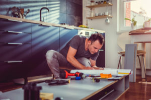 Douglaston Landlord Repairing the Kitchen Cabinets
