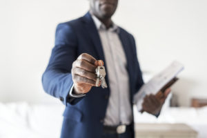 Valley Stream Real Estate Investor Holding Out a Set of Keys