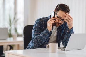 Stressed Burlingame Property Manager on the Phone