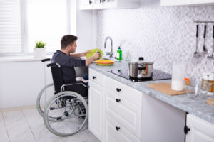 Bridgewater Tenant Cleaning Dishes in the Kitchen from His Wheelchair