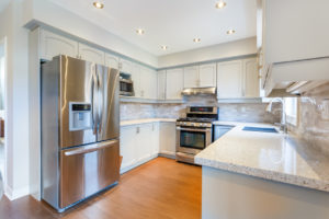 Stainless Steel Refrigerator in a Luxurious Kitchen
