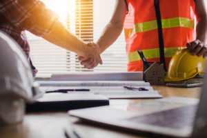 New Haven Contractor and Property Owner Shaking Hands