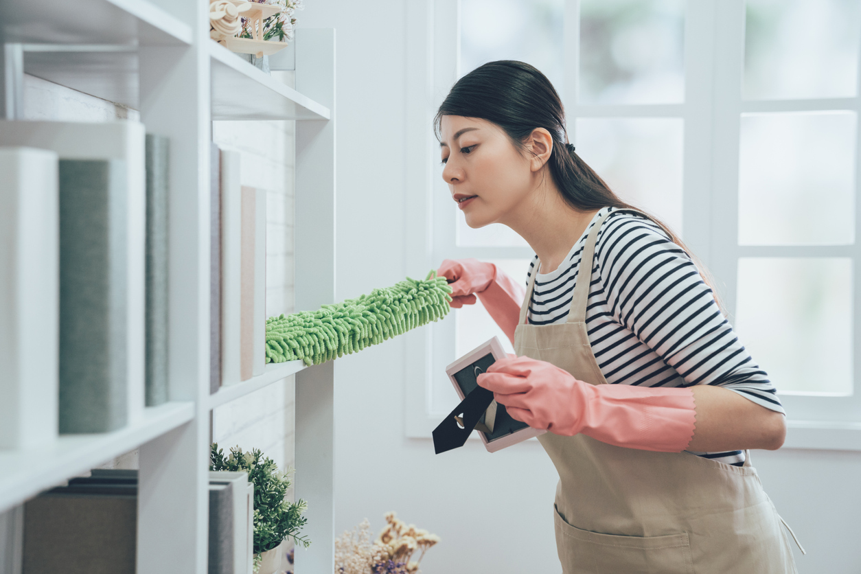 New Haven Woman Dusting a Shelf