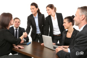 A Group of Professionals Conducting a Meeting